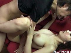 Horny Japanese milf, wearing panties, lets a man play with her snatch. Then she sucks the man's wang and they fuck in the cowgirl position on the sofa.