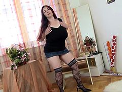 This mature redheaded slut has a really nice and saggy pair of tits. Her boobs looks good in her tight black shirt, and they look even better when we get to see her massive cleavage. She teases for the camera and even plays with her pussy a little bit.