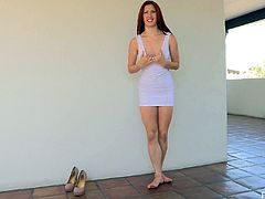 Check out this hot solo scene where the sexy redhead Melody fingers her pink pussy outdoors as you hear her moan.