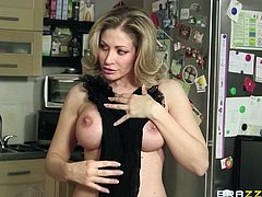 Horny blonde mom Vittoria Risi, wearing a bodystocking, is having fun with Christian Clay in the kitchen. The bitch gives a blowjob to the guy and lets him pound her twat from behind.