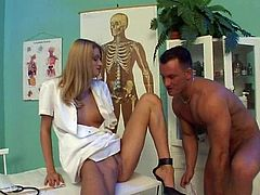 Engaging blonde Lisa D is having fun with a man in a doctor's office. They have ardent oral sex and bang doggy style and in the missionary position on a desk.