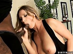 Brunette Devon Lee with huge jugs gets her honeypot fucked full of ram rod in interracial sex action