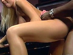 Press play to watch this blonde angel, with a nice ass and fake tits, while she has interracial sex with a black dude and a horny ebony watches.