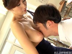 Desirable Japanese sexpot shows off her big natural boobs to the dude and lets him kiss them. Afterwards she provides him with awesome blowjob and great titfuck.