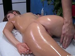 Cute Lily Carter is ready a nice pussy massage with a perverted masseur. He starts to rub oil allover her perfect body and starts to massage her tight pussy.