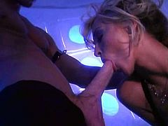 A passionate MILF in a corset and stockings sucks two big dicks skillfully. Then Jill gets fucked and jizzed on her big boobs.