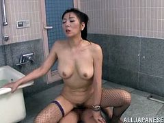 Take a look at this hardcore scene where this busty Asian milf is fucked by two studs in a threesome before taking a shower.