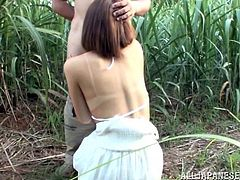 A horny Japanese bitch is walking in the field. She meets a nude black dude and kneels in front of him to play with his mighty black wang.