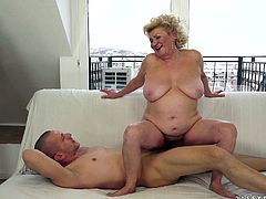A hot, mature woman with massive, natural tits and a hairy pussy enjoys a hardcore, doggy style fuck. Hear her scream with pleasure now!