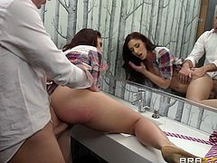 Amazing brunette chick with a pretty face gives a blowjob and gets fucked from behind in a restroom. Mischa also gets fucked and facialed on a sofa.