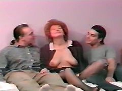 Curly and sandy haired hooker with huge button rides massive sausage in cowgirl position. Another kinky dude gets his cock sucked by that hot bitch. Look at that dirty FMM fuck in The Classic Porn sex clip!