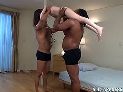 Charming Japanese girl is having fun with two black studs in ardent interracial MMF threesome scene. The dudes eat the skank's pussy by turns and then fuck it in many positions.