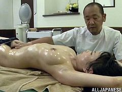 An oiled-up, Asian pornstar with big, natural tits and a hairy pussy enjoys a hardcore, doggy style fuck. Hear her scream with pleasure now!