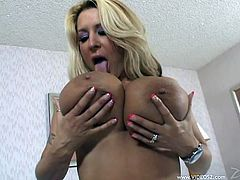 A fuckin' blonde hot ass milf sucks on this dude's cock and then rides it hard like a fuckin' cowgirl from fuckin' hell, check it out!