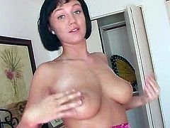 Press play to watch this brunette doll, with giant jugs wearing a cute dress, while she uses her hands on herself in a really erotic way.