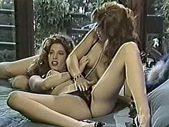 Curly haired whorish hotties with sexy shapes pleased saggy vaginas of one another with sex toys in flying position. Just look at that dirty lesbian fuck in The Classic Porn sex clip!
