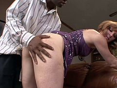 The gorgeous redhead Allison Wyte enjoys getting her tight ass fucked hard by a big black cock and ends up getting a nasty creampie.