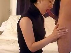 VIP Asian escort slut looks gorgeous in her black evening dress. Oriental slut sits on her knees and desirably sucks small hairy dick of her client.
