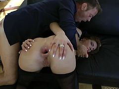 Dark haired temptress with lean body gives frantic blowjob to Rocco Siffredi. Then cutie bends over the couch letting her gaping booty hole stuffed with big anal plug.