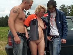 The buddies were driving around in their car and having all sorts of fun. When at the gas station they had this crazy idea. What if they pay this woman who worked there to show her tits? It all went further than they had expected! For that tip they gave her, she let them play with her big soft boobs and took a ride to the country with them for a hardcore fuck! Watch the crazy three get it on like rabbits. Her rosy shaved pussy got so much cock! She sucked and stroked both like a good slut and enjoyed a double fountain.