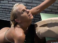 Blonde Barbie White exposes her assets while getting tongue fucked by lesbian Mandy Bright