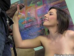 Get a boner by watching this brunette babe, with natural boobs and a shaved pussy, while she shows her tits and gets touched by a black dude.
