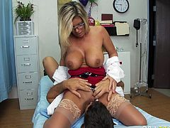 Well stacked blonde in sexy red lingerie and stockings rides face of one horny dude in the hospital. Her insatiable pussy deserves good tongue job and dude licks her pussy with pleasure.