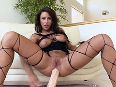 This amazingly hot Latina wears her sexy fishnet stockings while she toys her big cock-hungry asshole with a huge dildo.
