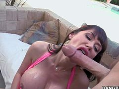 Eva Karera is a perfect bodied passionate milf pornstar with fake huge round firm tits. Her tits are absolutely amazing. She shows off her bombs while giving mouth job and getting her trimmed pussy boned. She takes cock after ass dildoing.