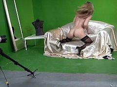Busty blonde in sexy black stockings masturbates in front of the camera