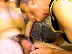 Take a look at this hot gay scene where this older guy sucks this stud's thick cock before riding him on the couch.