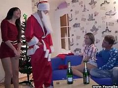 Checkout this guy dressed as Santa working his sex magic on a couple of pretty amateur chicks who love to party and fuck. His friend gets lucky too and joins the fun and with a bottle of Champagne and two firm creamy cocks these eager teen beauties get the Christmas Eve pre-party they'll never forget. Watch how these teen hotties suck and fuck two eager and horny cocks.