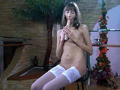 Florence A. takes off her dress and keeps on her lacy, white stockings. She has a long anal toy that she inserts inside her butt hole and masturbates with it.