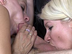 Take a look at this hardcore scene where this horny blonde milf and her sexy daughter share this guy's thick cock in a hot threesome.