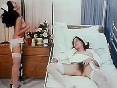 Bonny black haired slut lies in bed with legs spread apart and gets her hairy vagina investigated by her lusty kooky in white sex suit hard. Watch that steamy lesbo fuck in The Classic Porn sex video!