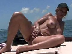 Slutty blonde MILF fishes on the boat being naked. After some time she starts to fondle her pussy because fishing is boring for her. Later on she also sucks a dick.