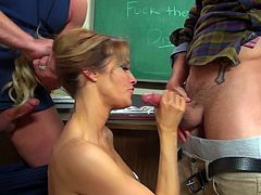This incredibly spoiled teacher can't be satisfied by one dick only. She sucks one stiff dick after another like a super qualified whore.