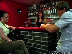 The bartender gets topless while she watches a hung stud fuck a drunk girl and cums all over her shaved, well-fucked pussy.