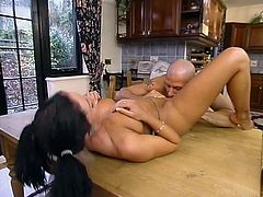 Petite brunette bitch is playing dirty games with a bald guy in the kitchen. The dude eats the tart's snatch and fucks it doggy style and in the cowgirl position.