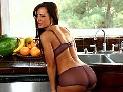 Checkout this stunning cougar Lisa Ann plays with her big round tits before climbing onto her kitchen countertop to rub her juicy wet pussy to orgasmic bliss. Wacky slut is looking damn hot and sexy wearing black lingerie set and fishnet stockings.