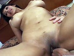 Make sure you take a look at this milf's big round tits in this hardcore scene before she's sucks on this guy's large cock and is fucked by him as well.