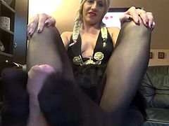 footjob by girl in black pantyhose