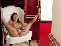 Brown-haired slut Celeste Star, wearing a bra and thong, kneads her tits and strokes her ass. Then she sits down in an arm chair and fingers her shaved pussy and bumhole.