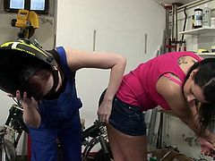 This gorgeous mechanic gets a little touchy with her hot lesbian client and they ends up shoving some big ass dildos up their wet pussies.