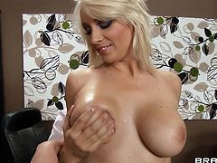 A very sexy woman with short blonde hair, massive natural tits and a shaved pussy enjoys a mind-blowing fuck in her office.