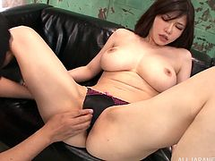 Hot Japanese woman shows her big boobs to a masked guy and pleases him with a titjob. After that she oils her body and allows the dude to pound her coochie in the missionary position.