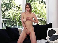 Horny brown-haired chick Beata Undine strips and plays with her nice natural tits. Then she rubs her shaved cunt and masturbates it with a dildo.