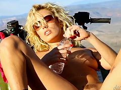 That light haired zealous hooker with big tits and in sunglasses posed on her cool four wheeler and set to fuck her kitty with fingers greedily. Enjoy that hottie in Fame Digital porn clip!
