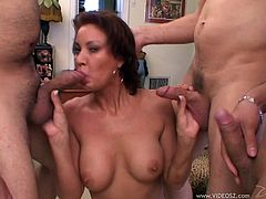Brown-haired mom Vanessa Videl is playing dirty games with a few men in the living room. She sucks and rubs the dudes' weiners, then gets fucked in many positions and facialed.