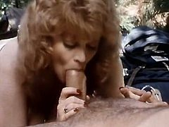 Fair haired bosomy MILF sucks hot cock of her young lover in forest